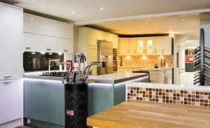 modern fitted kitchen with taps
